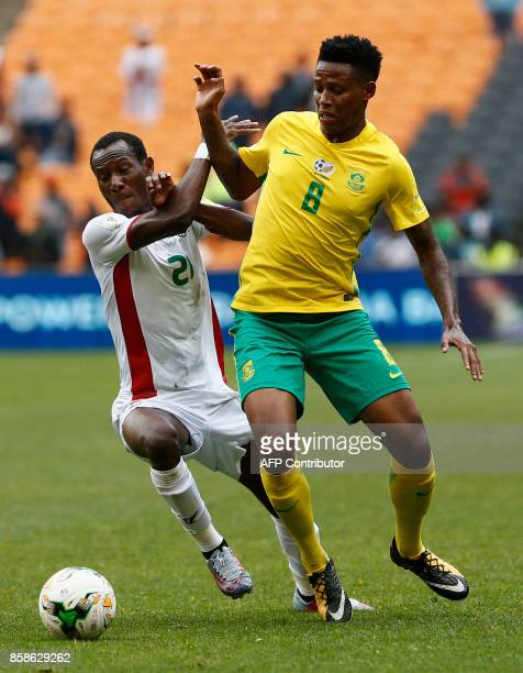 South Africa's Bongani Zungu is tackled by Burkina Faso's Cyrille Bayala during the World Cup 2018 qualifier football match at the city stadium on...