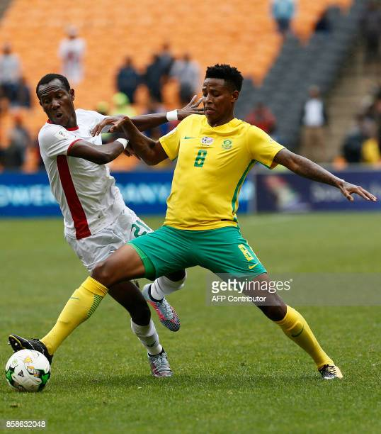 South Africa's Bongani Zungu vies with Burkina Faso's Cyrille Bayala during the World Cup 2018 qualifier football match between South Africa and...