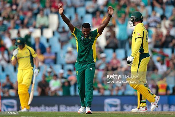South Africa's bowler Andile Phehlukwayo celebrates after dismissing Australia's batsman John Hastings during the first One Day International cricket...