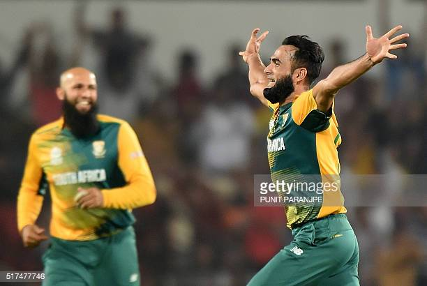 South Africa's bowler Imran Tahircelebrates after taking the wicket of West Indies batsman Darren Sammy during the World T20 cricket tournament match...