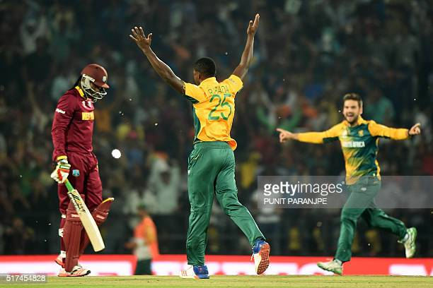 South Africa's bowler Kagiso Rabada celebrates after taking the wicket of West Indies batsman Chris Gayle during the World T20 cricket tournament...