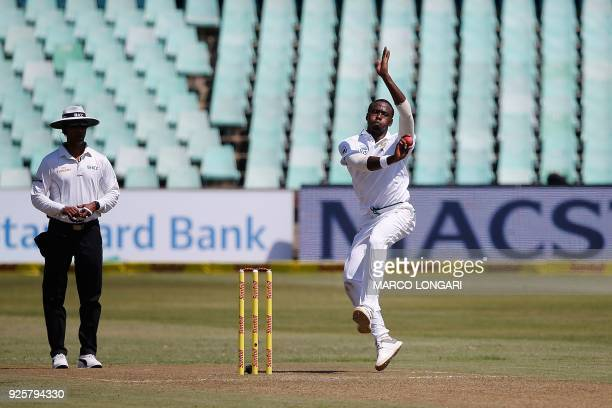 South Africa's bowler Kagiso Rabada delivers the ball during day one of the first Sunfoil Test between South Africa and Australia at Kingsmead...
