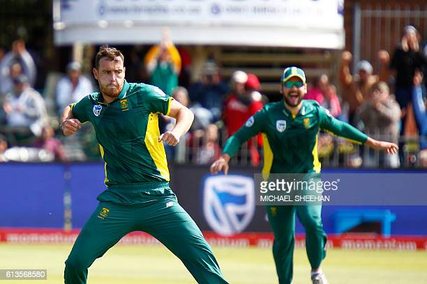 South Africa's bowler Kyle Abbott celebrates taking the wicket of Australia's Aaron Finch during the fourth One Day International between South...