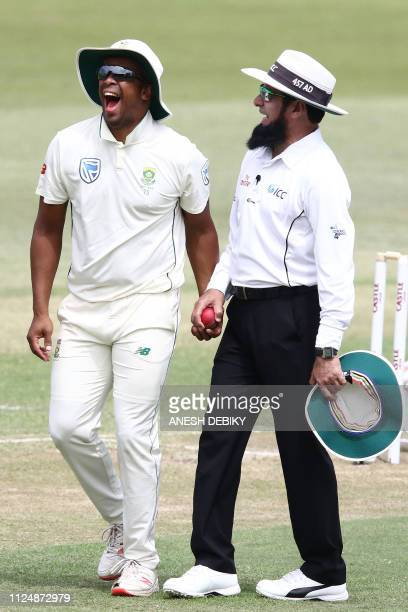 South Africa's bowler Vernon Philande shares a laugh with umpire Aleem Dar during the day 2 of the first test match between South Africa and Sri...