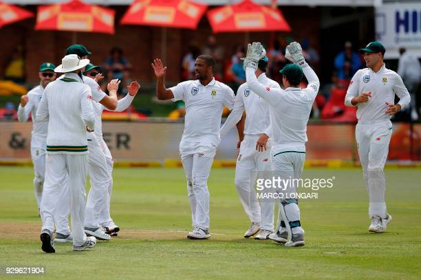 South Africa's bowler Vernon Philander celebrates taking the wicket of Australia's batsman Usman Khawaja during day one of the second Sunfoil Test...