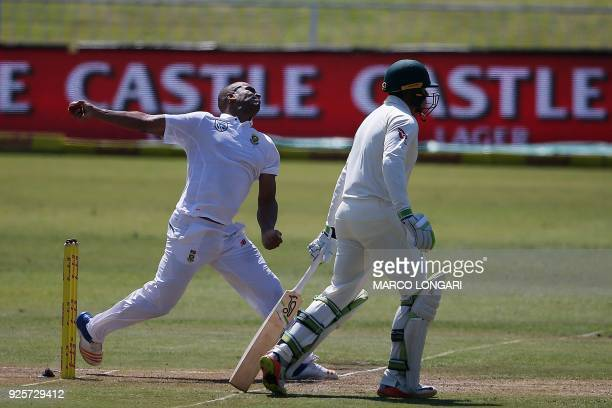 South Africa's bowler Vernon Philander delivers the ball to Australia's batsman David Warner during day one of the first Sunfoil Test between South...