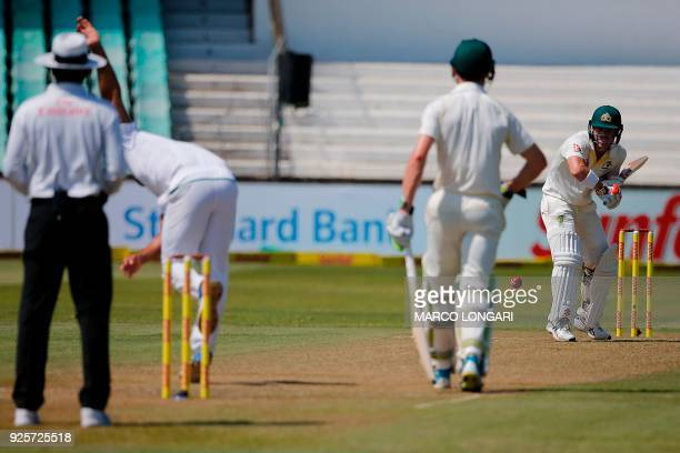 South Africa's bowler Vernon Philander delivers to Australia's batsman David Warner during day one of the first Sunfoil Test between South Africa and...