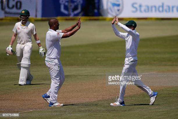 South Africa's bowler Vernon Philander is celebrated after dismissing Australia's batsman David Warner during day one of the first Sunfoil Test...