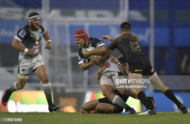 South Africa's Bulls hooker Schalk Brits is tackled by Argentina's Jaguares centre Jeronimo De La Fuente and flyhalf Jaquin Diaz Bonilla during their...