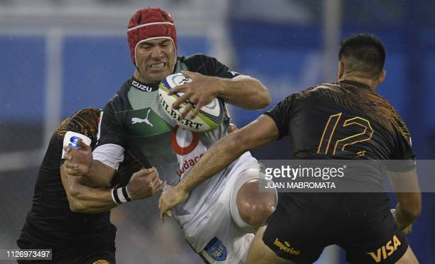 South Africa's Bulls hooker Schalk Brits runs through a tackle by Argentina's Jaguares flyhalf Jaquin Diaz Bonilla and centre Jeronimo De La Fuente...