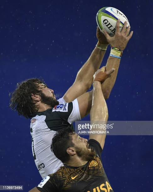 TOPSHOT South Africa's Bulls lock Lood De Jager reaches for the lineout ball against Argentina's Jaguares N8 Javier Ortega during their Super Rugby...