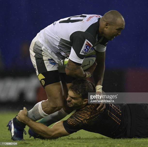 South Africa's Bulls wing Cornal Hendricks is tackled by Argentina's Jaguares wing Ramiro Moyano during their Super Rugby match at the Jose...