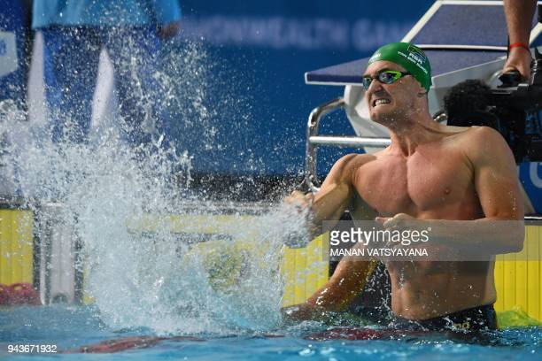 South Africa's Cameron van der Burgh celebrates winning the swimming men's 50m breaststroke final during the 2018 Gold Coast Commonwealth Games at...