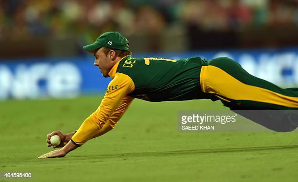 South Africa's captain AB de Villiers takes a catch of West Indies batsman Jonathan Carter during the 2015 Cricket World Cup Pool B match between...