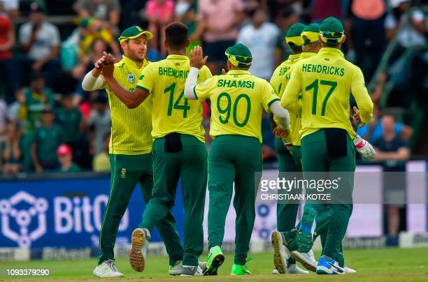 South Africa's captain David Miller celebrates with teammate Beuran Hendricks after getting the wicket of unseen Pakistan batsman Fakhar Zaman during...