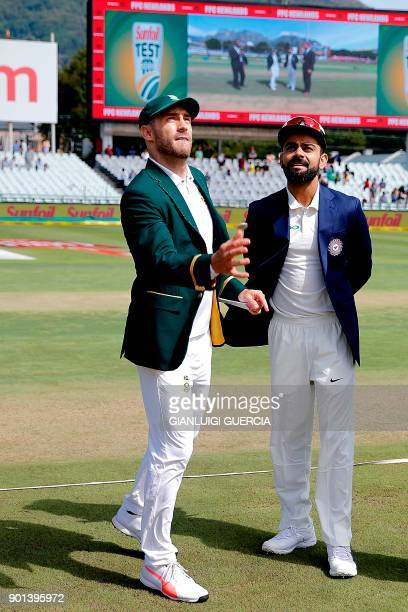 South Africa's captain Faf du Plessis and India's captain Virat Kohli toss the coin during Day One of the First Test match between South Africa and...