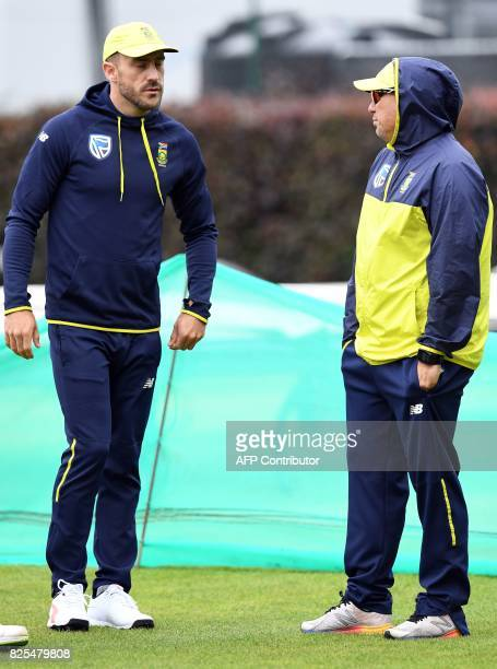 South Africa's captain Faf du Plessis and South Africa's coach Russell Domingo attend a nets practice session at Old Trafford cricket ground in...