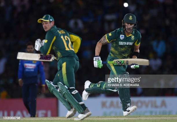South Africa's captain Faf du Plessis and teammate Quinton de Kock run between the wickets during the second oneday international cricket match...