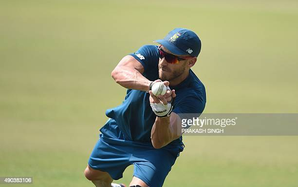 South Africa's captain Faf du Plessis catches the ball during a training session for the practice cricket match between the Indian Board President's...