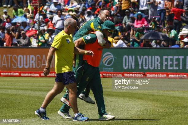 South Africa's captain Faf du Plessis leaves the field after being injury during their ODI oneday international match at the Buffalo Park Cricket...