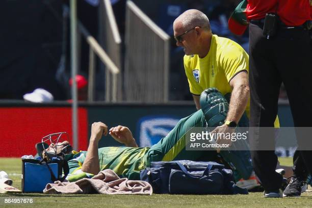 South Africa's captain Faf du Plessis receives treatment after being injury during their ODI oneday international match at the Buffalo Park Cricket...
