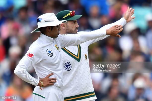 South Africa's captain Faf du Plessis talks to South Africa's Keshav Maharaj on the fourth day of the third Test match between England and South...