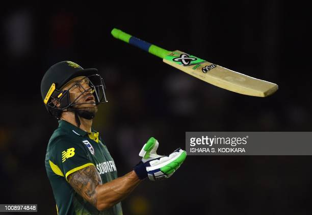 South Africa's captain Faf du Plessis throws his bat in the air as he walks back to the pavilion after his dismissal during the second oneday...