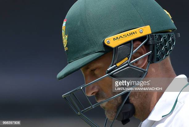 South Africa's captain Faf du Plessis walks back to the pavilion after his dismissal during the third day of the opening Test match between Sri Lanka...