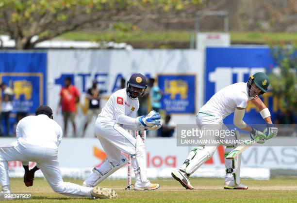 South Africa's captain Faf du Plessis watches as Sri Lanka's Angelo Mathews takes a catch to dismiss himm as wicketkeeper Niroshan Dickwella reacts...