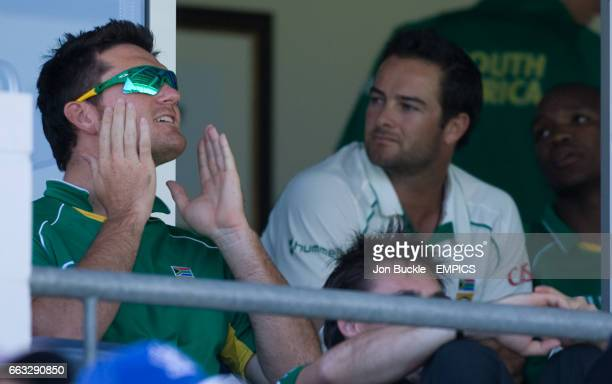 South Africa's captain Graeme Smith and Mark Boucher watch on as AB DeVilliers and JeanPaul Duminy bring them closer to victory over Australia on day...