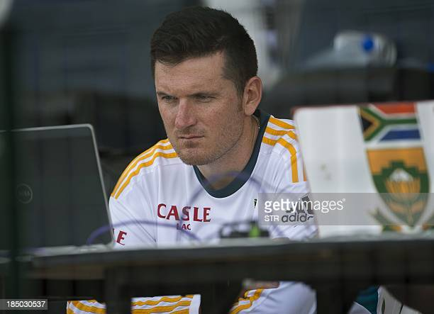 South Africa's captain Graeme Smith keeps a close eye on his batsman during their match against Pakistan on the fourth day of their first Test at the...