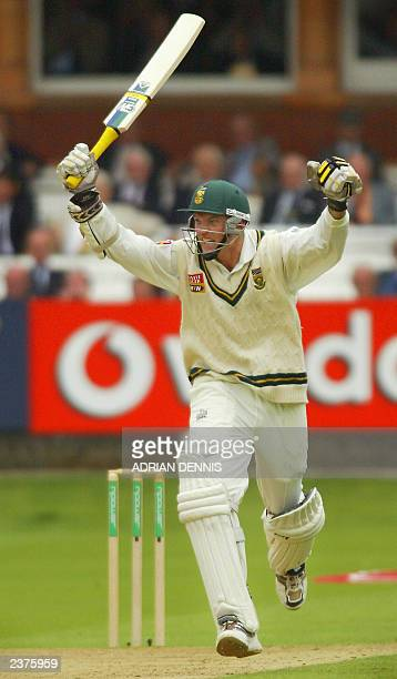 South Africa's Captain Graeme Smith runs down the wicket as he celebrates scoring his doublecentury against England during the first innings of the...