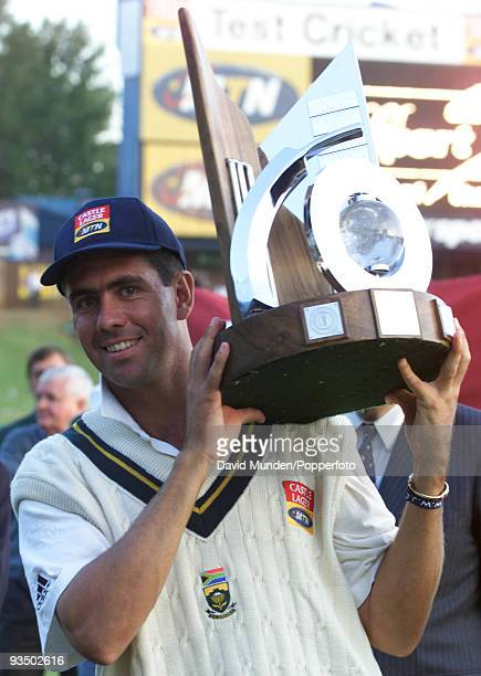 South Africa's captain Hansie Cronje with the trophy for winning the series 2-1 after the 5th Test match between South Africa and England at...