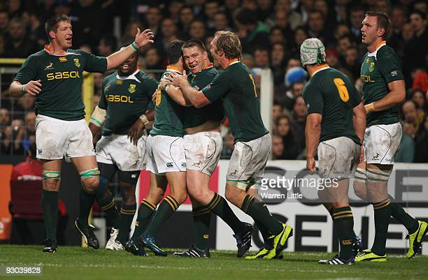 South Africa's captain John Smit is congratulated after scoring the opening try during the international match between France and South Africa at...