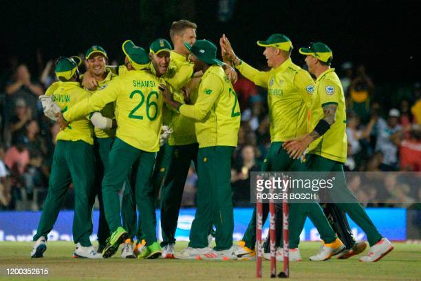 South Africa's captain Quinton de Kock celebrates with teammates their victory over England during the first T20 cricket match between South Africa...