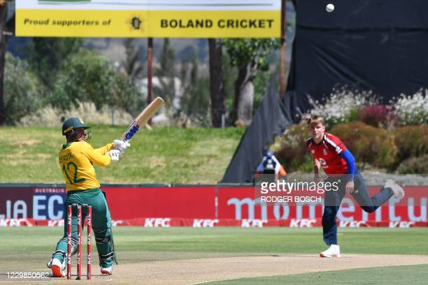 South Africa's captain Quinton de Kock plays a shot delivered by England's Sam Curran during the second T20 international cricket match between South...