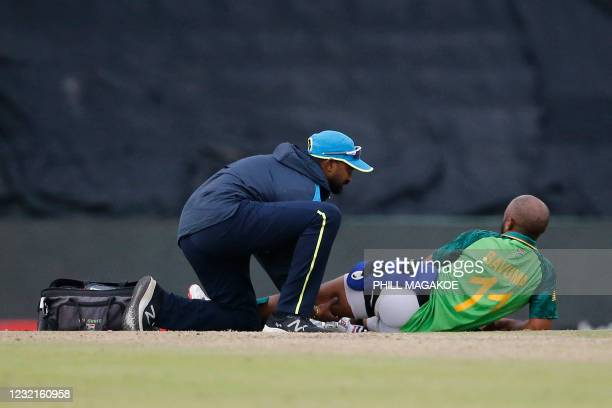 South Africa's captain Temba Bavuma receives medical attention during the third one-day international cricket match between South Africa and Pakistan...