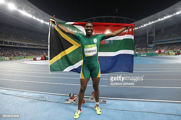South Africa's Caster Semenya celebrates winning the gold medal in the Women's 800m Final during the athletics event at the Rio 2016 Olympic Games at...