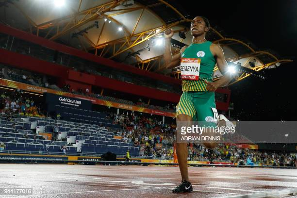 TOPSHOT South Africa's Caster Semenya crosses the finish line to win the athletics women's 1500m final during the 2018 Gold Coast Commonwealth Games...