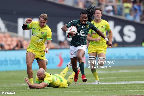 South Africa's Cecil Afrika races away for a try during the World Rugby Sevens Series semi final match between Australia and South Africa at Waikato...