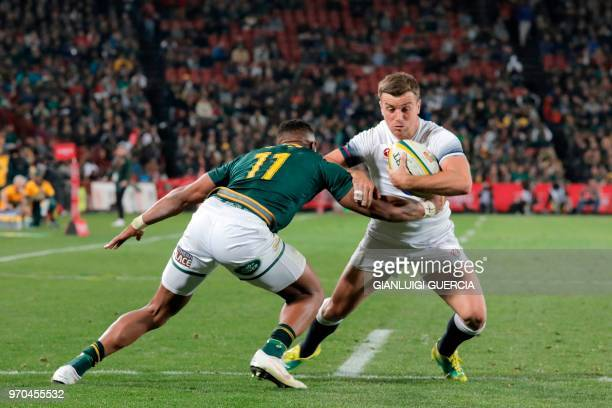 South Africa's centre Aphiwe Dyantyi tackles England's flyhalf George Ford during the first rugby union test match between SouthAfrica and England at...