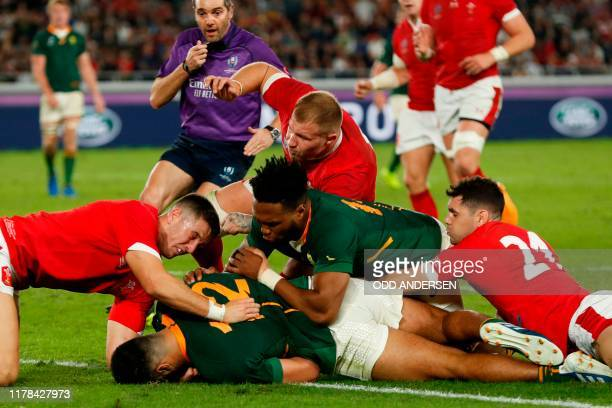South Africa's centre Damian De Allende scores a try during the Japan 2019 Rugby World Cup semifinal match between Wales and South Africa at the...