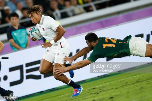 TOPSHOT South Africa's centre Damian De Allende tackles England's wing Anthony Watson during the Japan 2019 Rugby World Cup final match between...