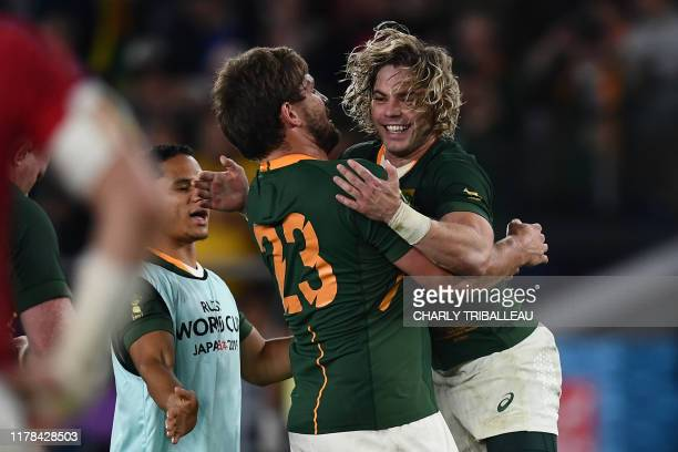 South Africa's centre Frans Steyn hugs South Africa's scrum-half Faf de Klerk after winning the Japan 2019 Rugby World Cup semi-final match between...