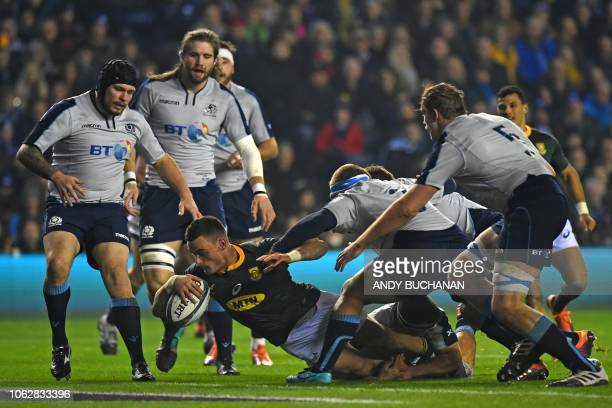 South Africa's centre Jesse Kriel dives over the line to score the opening try of the autumn international rugby union test match between Scotland...
