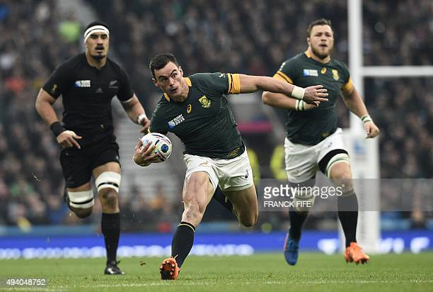 South Africa's centre Jesse Kriel runs with the ball during a semifinal match of the 2015 Rugby World Cup between South Africa and New Zealand at...