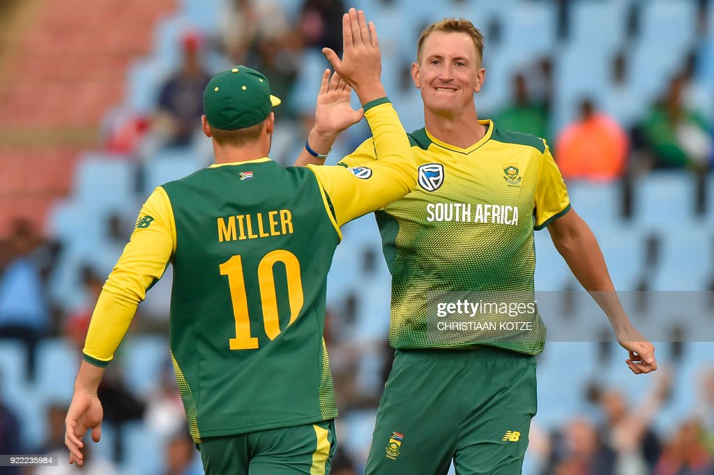 South Africa's Chris Morris (R) and teammate David Miller react to a possible leg before wicket (LBW) decision during the second T20I cricket match between South Africa and India at Super Sport Park Stadium in Pretoria on February 21, 2018. / AFP PHOTO / Christiaan Kotze