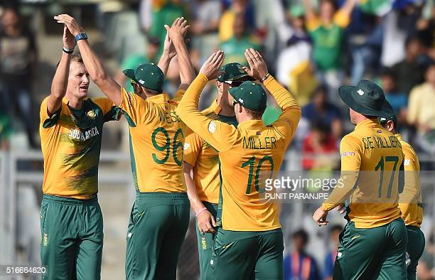 South Africa's Chris Morris celebrates with teammates after taking the wicket of Afghanistan's Mohammad Shahzad during the World T20 cricket...