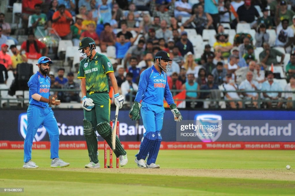 South Africa's Chris Morris (C) is dismissed for leg before wicket (LBW) after being struck in the groin by the ball during the One Day International (ODI) cricket match between India and South Africa at Newlands Stadium on February 7, 2018, in Cape Town. /