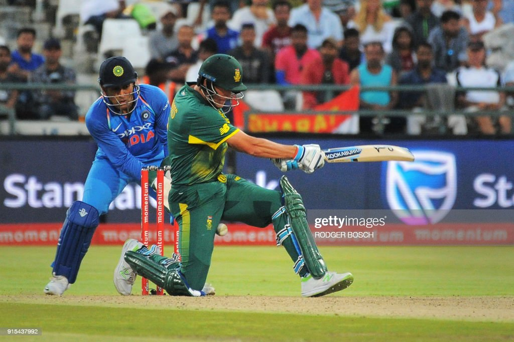 South Africa's Chris Morris (R) is struck in the groin by the ball as he bats during the One Day International (ODI) cricket match between India and South Africa at Newlands Stadium on February 7, 2018, in Cape Town. /